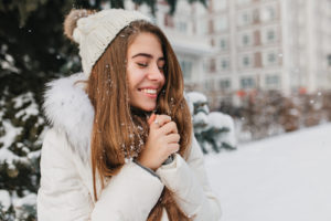Joyful woman in snow